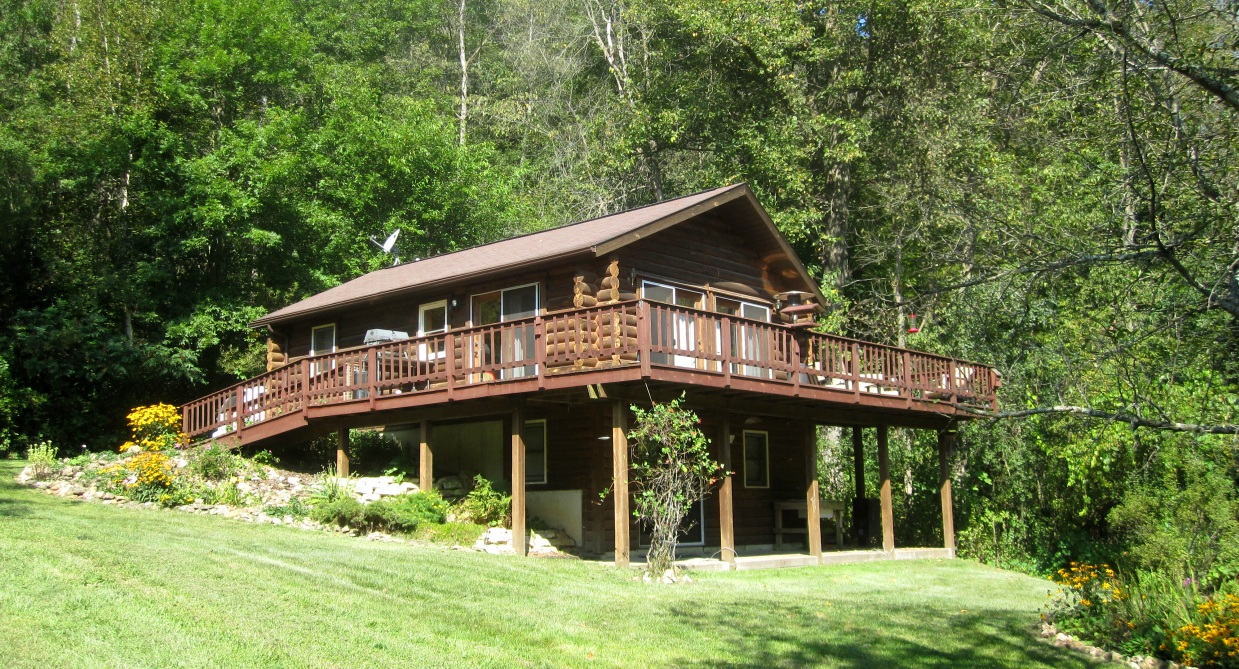 Property from rush creek realty for Log cabin with basement